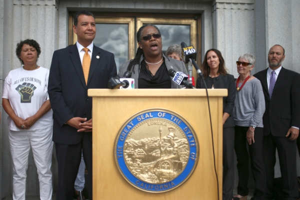 Alameda County Chief Probation Officer LaDonna M. Harris speaks as California Secretary of State Alex Padilla, second from left, looks on during a news conference at the Rene C. Davidson Courthouse in Oakland on Aug. 4, 2015.