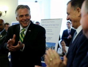 Virginia Gov. Terry McAuliffe,left, leads applause during an announcement at the State Capitol in Richmond Tuesday, Sept. 2, 2014, of a major gas pipeline through parts of Virginia, West Virginia and North Carolina.