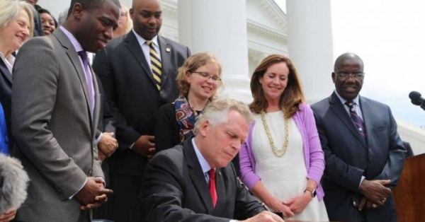 Virginia Governor Terry McAuliffe signs an order restoring voting rights to more than 200,000 Virginians on April 22, 2016.
