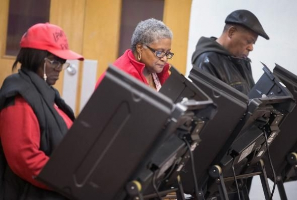 Residents cast their votes at a polling place on Nov. 4, 2014 in Ferguson, Missouri. The Brennan Center found only four cases of in-person voter fraud in the state.
