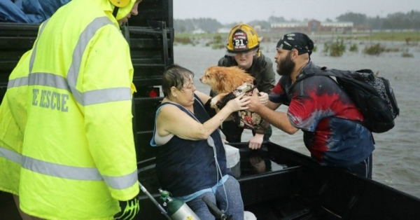 An emergency crew rescues a woman and her dog from their flooded home during Hurricane Florence Sept. 14, 2018 in James City, North Carolina.