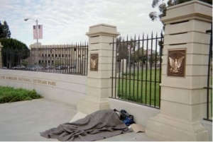 A homeless individual sleeps outside the V.A.'s West L.A. campus