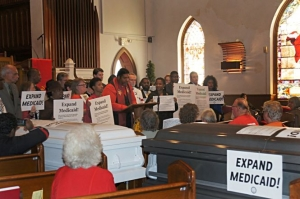 The N.C. NAACP held a mock funeral this week to dramatize the effect of the state's refusal to expand Medicaid to 500,000 residents. The next day, N.C. House Speaker and U.S. Senate candidate Thom Tillis -- an outspoken opponent of Medicaid expansion -- said the state should consider it.